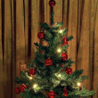 Small Christmas tree with electric candles in retro style — Zdjęcie stockowe