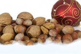 Christmas tree ball and nuts on white background — Stock Photo