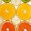Royalty-Free Stock Photo: Background of kiwi, grapefruit, orange and lemon disks
