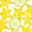 Background from the fruit of carambola slices on white background — Stock Photo