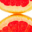 Macro shot of two quarter slice of grapefruit — Stock Photo