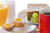 Breakfast with eggs, coffee and orange juice — Stock Photo