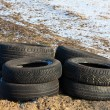 Illegally disposed of tires by the wayside — Stok fotoğraf