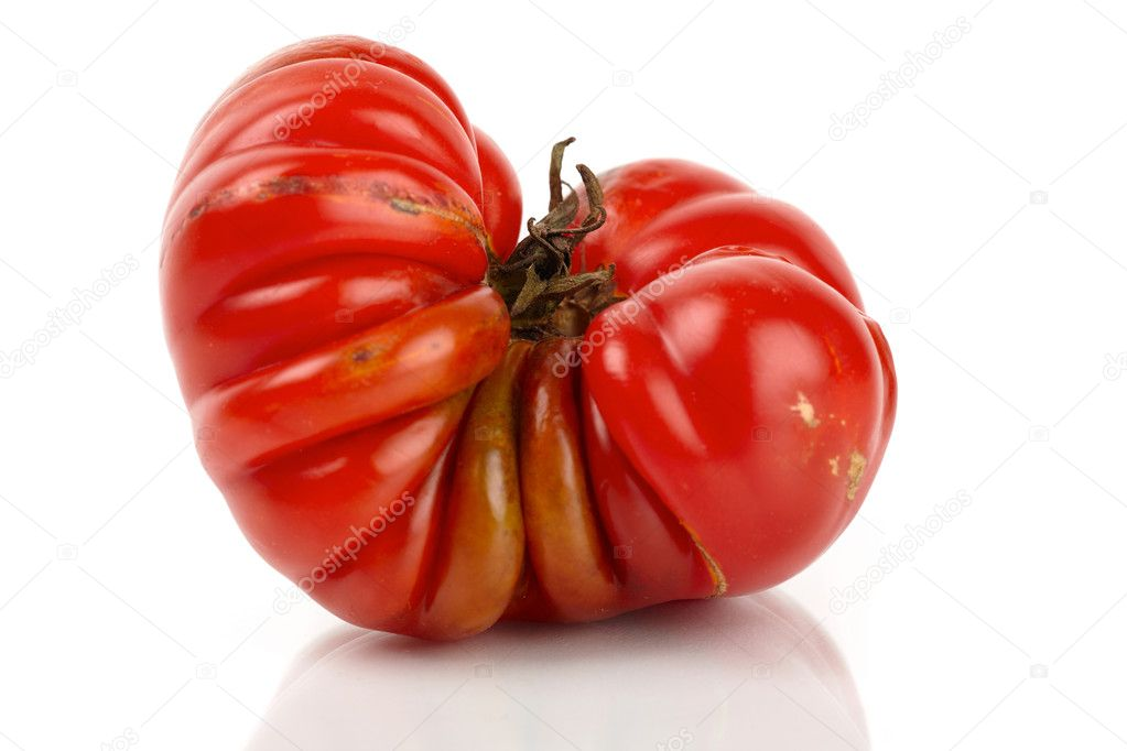 Large red giant beefsteak tomato mirror in front of white background — Stock Photo #9599664