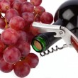 Wine bottle with corkscrew and grapes on a white background - Stock Photo
