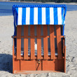 Stock Photo: Wicker beach chairs on the beach of the Baltic Sea
