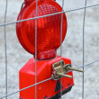 Red construction site warning lamp - Stock Photo