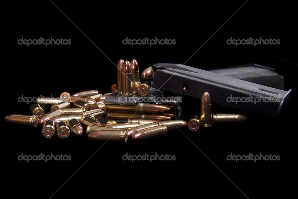 Loaded gun magazine and ammunition isolated on black — Stock Photo #9934058