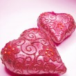 Foto Stock: Pink candles set heart shape