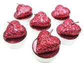 Velas de color rosa aroma spa situado en forma de corazón — Foto de Stock