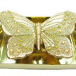 Bronze candle butterfly shape — Stock Photo