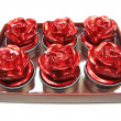 Foto Stock: Red candles set rose flower shape
