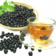 Stock Photo: Fruit tewith black currant extract