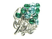 Jewelry ring with bright green crystals — Stock Photo