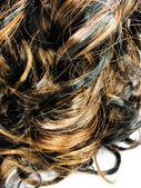 Dark curly highlight hair texture background — Stock Photo
