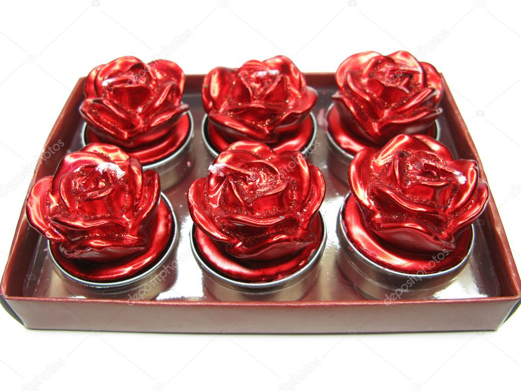 Set of rose candles as present in red box — Stock Photo #10092148