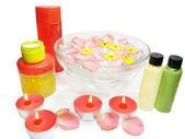 Spa bowl with rose petals and shampoo cremes — Stock Photo