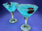 Two alcohol blue curacao liqueur cocktails with cherry — Stock Photo