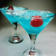 Blue lagoon liqueur cocktail with cherry — Stock Photo