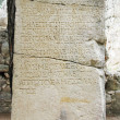 Ancient ruins written words on stone turkey — Стоковая фотография