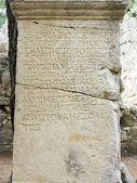 Ancient ruins written words on stone turkey — Stock Photo