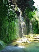 Waterfall out of grotto kursunlu — Stock Photo