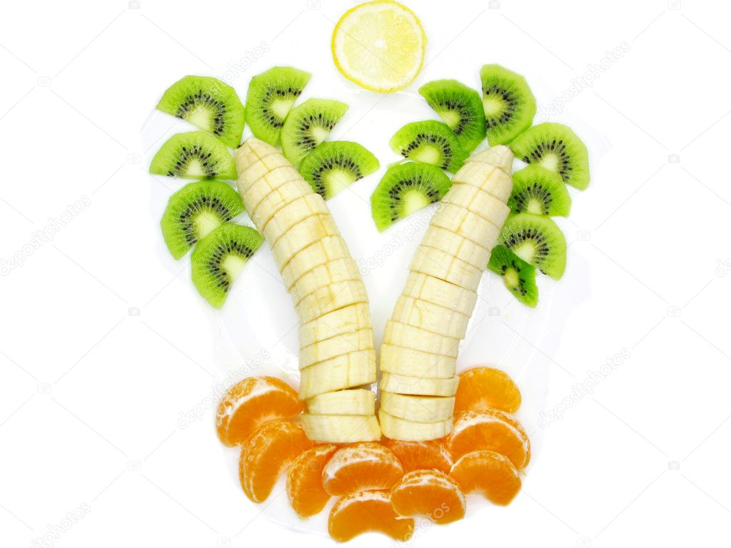 Creative fruit dessert with kiwi banana and orange palm tree shape  Stock Photo #10525902