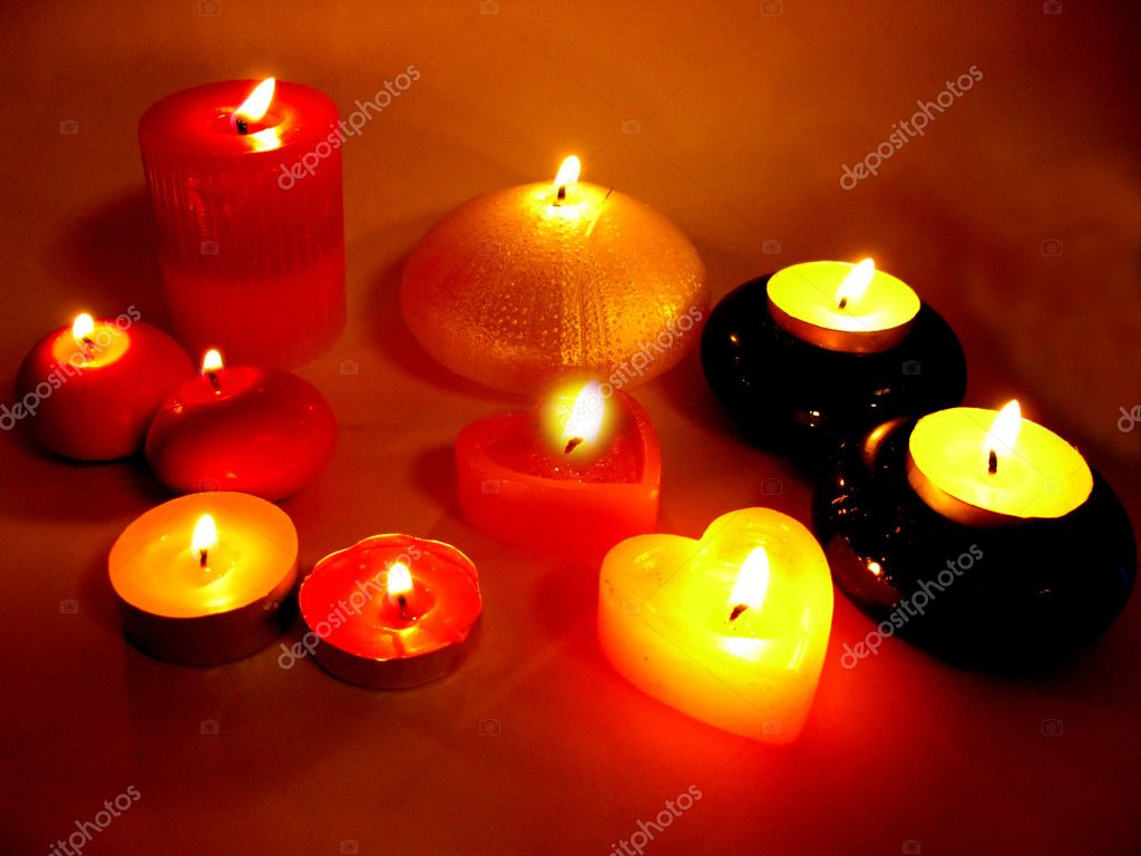 Spa group of lit candles in darkness — Stock Photo #10526013