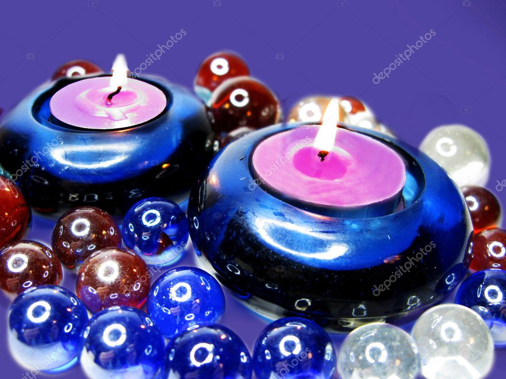 Spa candles among colorful glass stones — Stock Photo #10526037