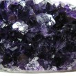 Foto Stock: Amethyst crystals texture geological background