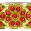 Stock Photo: Sweets in red envelopment in gold box