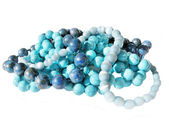 Composition of three-colored blue beads — Stock Photo