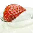 Strawberry in cream — Stock Photo