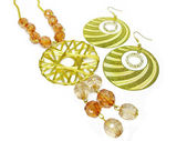 Gold earrings and beads — Стоковое фото