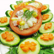 Stuffed tomato with cucumber and carrot - Stock Photo