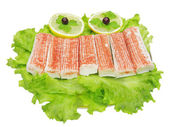 Fish product on lettuce vegetable — Stock Photo