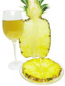 Cut pineapple and red white wine — Stock Photo