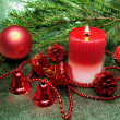 Red christmas balls candle and ribbon — Stock Photo