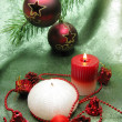 Red christmas balls and scented candles — Stock Photo