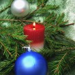 Red christmas balls and candle — Stok Fotoğraf #9626924