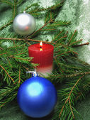 Red christmas balls and candle — Stock Photo