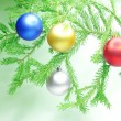 Christmas balls hanging on fir branch — Stock Photo