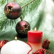 Red christmas balls candles ribbon — Stock Photo