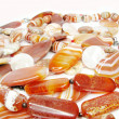 Heap of red semiprecious beads — Stock Photo