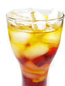 Fruit cold juice drink with lemon and raspberry — Stock Photo