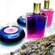 Stock Photo: Spa candles lavender aroma oils