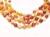 Röd orange och gul karneol pärlor — Stockfoto
