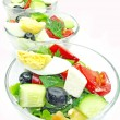 Greek salad in three portion bowls — Stock Photo