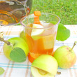 Fruit summer pouring tea with apple — Stock Photo