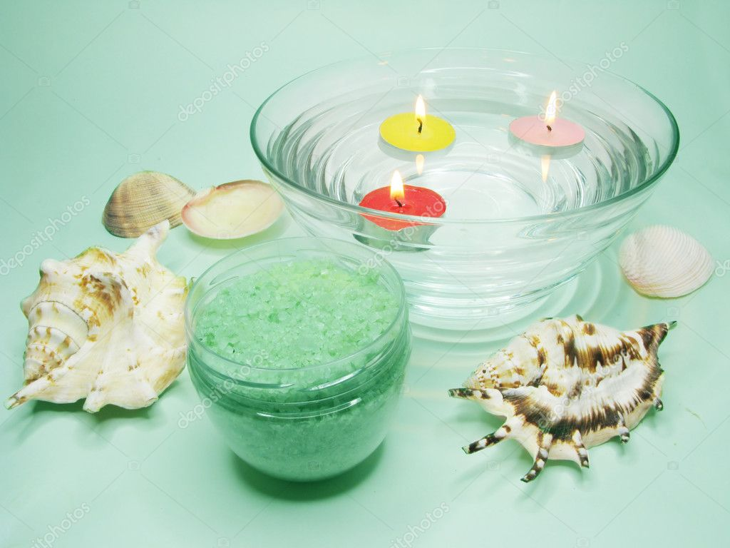 Spa lit candles bathing salt sea shells and essences  Stock Photo #9840621
